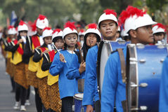 Marching band. The delegation marching bands enliven carnival culture, in the middle Solo,central Jawa city, Indonesia Royalty Free Stock Image