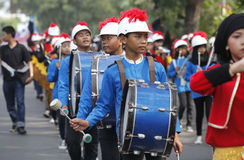 Marching band. The delegation marching bands enliven carnival culture, in the middle SoloJawa city, Indonesia Royalty Free Stock Photography