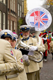 Marching band dressed in uniform playing music Royalty Free Stock Photos
