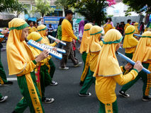 Marching band. Elementary school students in the city of Solo, Central Java, Indonesia playing marching band  in the street Stock Images