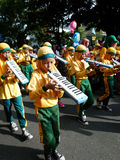Marching band. Elementary school students in the city of Solo, Central Java, Indonesia playing marching band  in the street Royalty Free Stock Photography