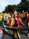 Marching band. Elementary school students in the city of Solo, Central Java, Indonesia playing marching band  in the street Royalty Free Stock Image