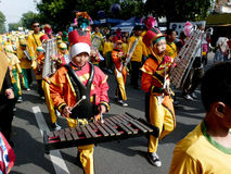 Marching band. Elementary school students were playing marching band on the street in the city of Solo, Central Java, Indonesia Royalty Free Stock Image