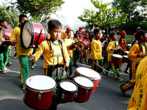 Marching band. Elementary school students were playing marching band on the street in the city of Solo, Central Java, Indonesia Royalty Free Stock Photos