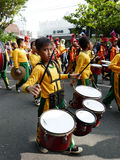 Marching band. Elementary school students were playing marching band on the street in the city of Solo, Central Java, Indonesia Stock Images