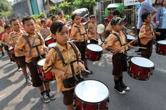 Marching band. Elementary students are practicing marching band outside the classroom in the city of Solo, Central Java, Indonesia Stock Images