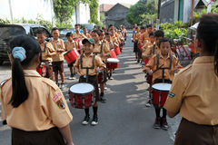 Marching band. Elementary students are practicing marching band outside the classroom in the city of Solo, Central Java, Indonesia Royalty Free Stock Images