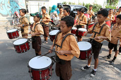 Marching band. Elementary students are practicing marching band outside the classroom in the city of Solo, Central Java, Indonesia Stock Photos