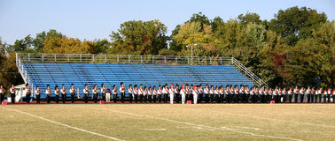 Marching Band Festival. A high school marching band gets ready to perform at a band festival royalty free stock photography