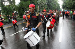 Marching band. Government employees marching band playing during the commemoration of the birthday of governance in the city of Solo, Central Java, Indonesia Stock Image