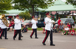 Marching band of The Governor General's Horse Guards during the Canada Day Parade. At part of Young Street in Aurora, Canada on July 1, 2013 stock photography