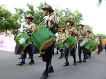 Marching band. Islamic organizations  Marching band appear in a parade in the streets of Solo, Central Java, Indonesia Royalty Free Stock Photos