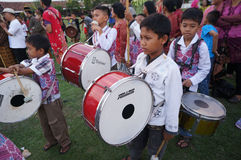 Marching band. The village children were practicing marching band in a square in the city of Solo, Central Java, Indonesia Royalty Free Stock Photo