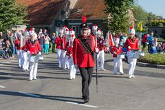 Marching band walking in a Dutch countryside parade Stock Photography