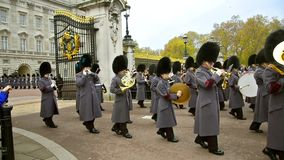 Marching bands at ceremony of Changing the guards at Backingham palace in London stock video