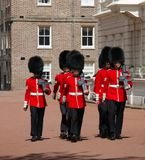 Marching british guards royalty free stock photo