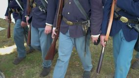 Marching Civil War soldiers come to a full stop stock video footage