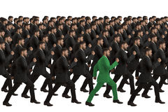 Marching Clones with green individual. Studio Shot royalty free stock images