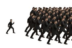 Marching Clones and Individual. Studio Shot Stock Photos