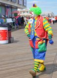 Marching Colorful Clown. Colorful adult clown marching on the boardwark during Clownfest. Taken September 14, 2014 Royalty Free Stock Images