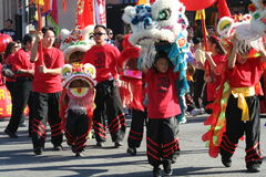 Marching Dragons. Children in Dragon Costumes marching in a Chinese new Year Parade Stock Images