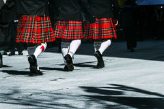 Marching kilts. Traditional attire for a march on st.patricks day stock image