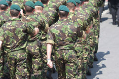 Marching Marines. British Royal Marines marching in DPM (disruptive pattern material) battle fatigues Royalty Free Stock Images