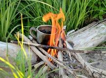 Marching mug on a bonfire Royalty Free Stock Image