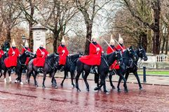 Marching the Queen`s Guards during traditional Changing of the Guards ceremony. At Buckingham Palace in London, United Kingdom Royalty Free Stock Photos