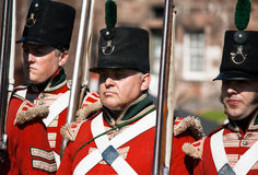 Marching Redcoats. FORT GEORGE, SCOTLAND- AUGUST 11 : Redcoat soldiers marching during the annual Celebration of the Centuries event at Fort George, Scotland Royalty Free Stock Images