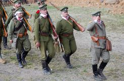 Marching Russian soldiers-reenactors. Osovets battle reenactment Stock Photography