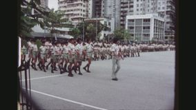 Marching Scouts. HONGKONG, KOWLOON, MAY 1978. Groups Of Boy And Girl Scouts Marching With Their Flag In The Yard Of The Headquarters Of The Scout Association Of stock video