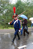 Marching soldier-reenactor. Stock Photos