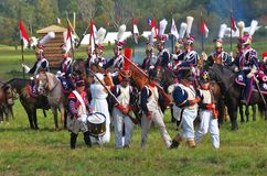 Marching soldiers and horse riders. Royalty Free Stock Image