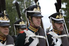 Marching soldiers-reenactors dressed as Russian army soldiers. BORODINO, MOSCOW REGION - SEPTEMBER 04, 2016: Marching soldiers-reenactors play drums at Borodino Royalty Free Stock Images