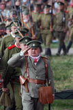 Marching soldiers-reenactors. The first man salute Stock Images