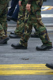 Marching Soldiers and Sailors. Servicemen and women march in formation Stock Image