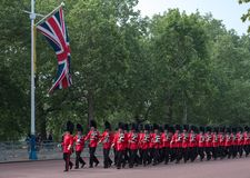 Marching soldiers walking down The Mall in London, UK. Photo taken during the Trooping the Colour ceremony. Marching soldiers with rifles walking down The Mall Stock Photo