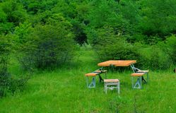 Marching table with chairs on a green glade Royalty Free Stock Photos