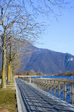 Marciapiede. Sidewalk along the lake with railing Stock Photo