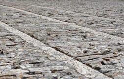 Marciapiede di pietra nella prospettiva, fondo Fotografia Stock Libera da Diritti
