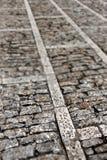 Marciapiede di pietra, piccola profondità di campo Fotografia Stock