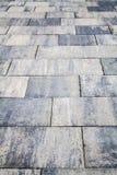 Marciapiede grigio delle mattonelle Fondo, struttura fotografia stock