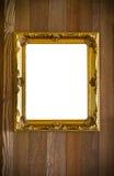 Marco antiguo de oro en el fondo de madera foto de archivo
