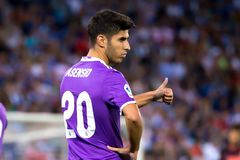 Marco Asensio plays at the La Liga match between RCD Espanyol and Real Madrid CF at RCDE Stadium. BARCELONA - SEP 18: Marco Asensio plays at the La Liga match stock photo