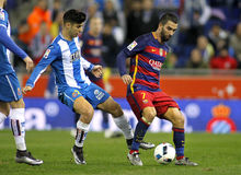 Marco Asensio of RDC Espanyol vies with Arda Turan of FC Barcelona Royalty Free Stock Image