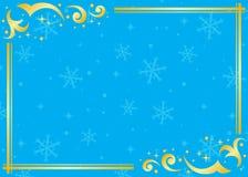 Marco azul y de oro con los copos de nieve Imagen de archivo
