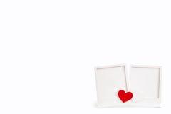 Marco blanco con los corazones Fotos de archivo libres de regalías