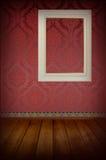 Marco blanco en la pared. Foto de archivo