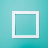 Marco blanco en un fondo del color Imagen de archivo